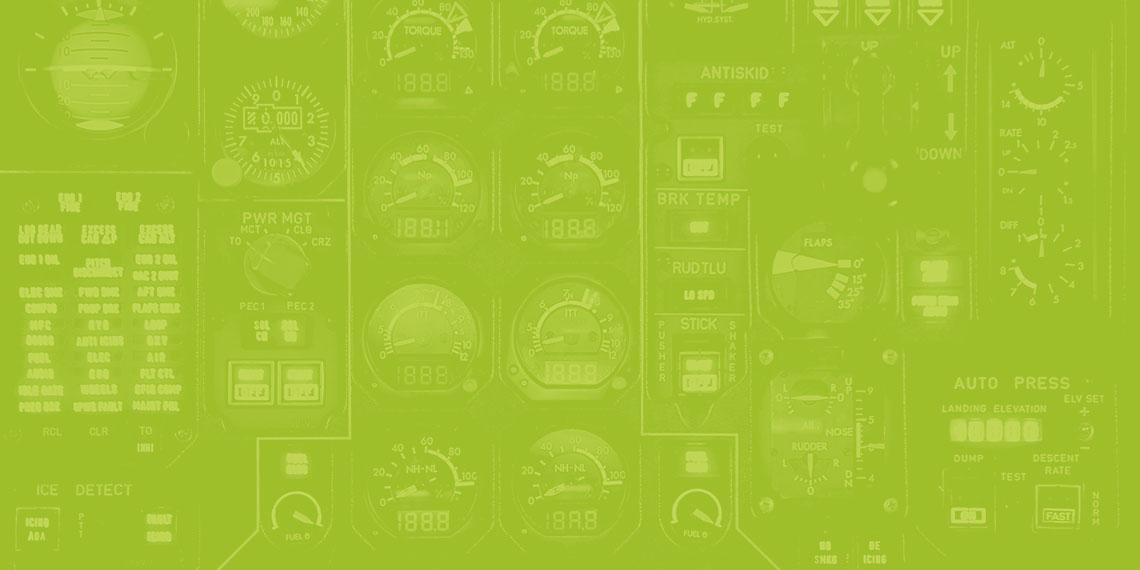 Imagem em tons de verde de vários relógios e medidores.